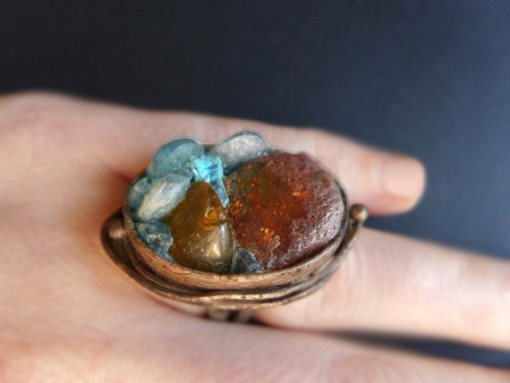 That Look of Otherness. Rustic Baltic Amber and apatite ring