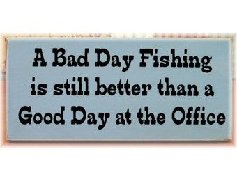 A bad day fishing is still better than a good day at the office primitive wood sign