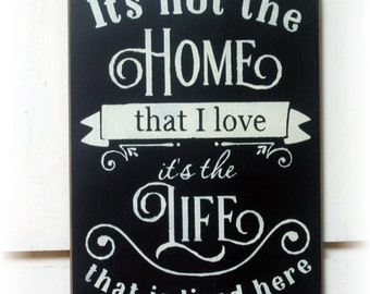 It's not the home that I love it's the life that I lived here wood sign
