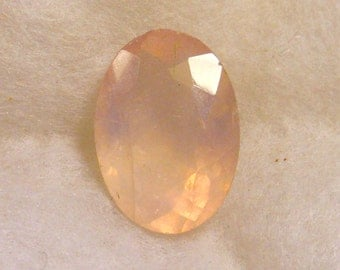 47 carat ...  rose quartz faceted gemstone ... 29 x 21 x 14 MM