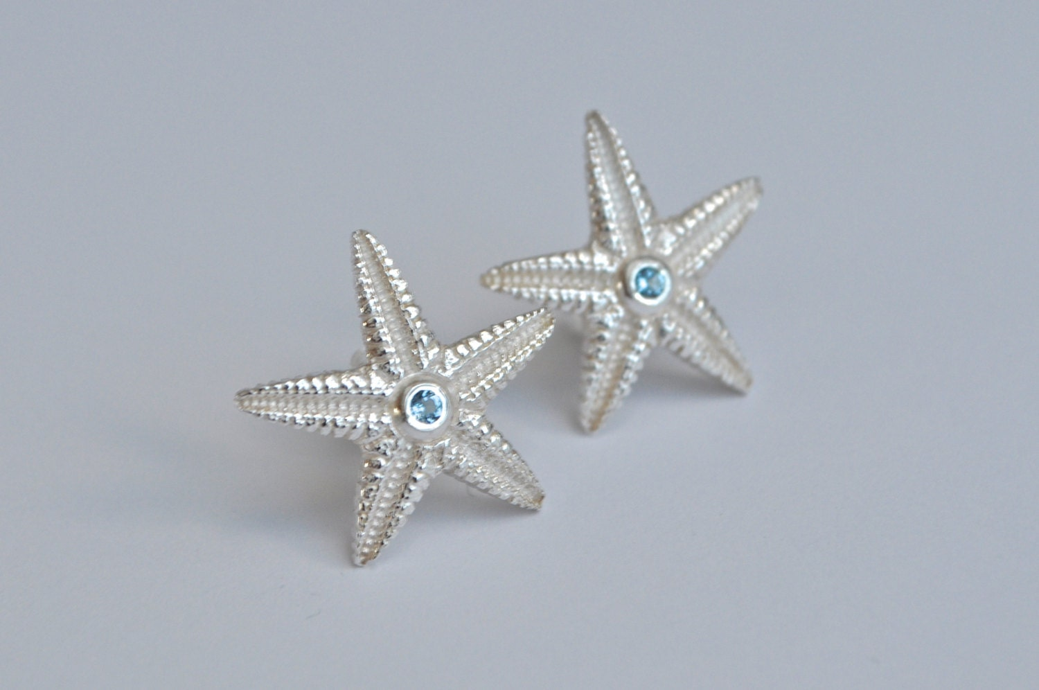 textured silver starfish earrings aquamarine by