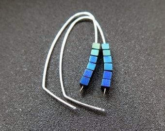 peacock jewelry. hematite earrings. indigo, blue and green hoops.