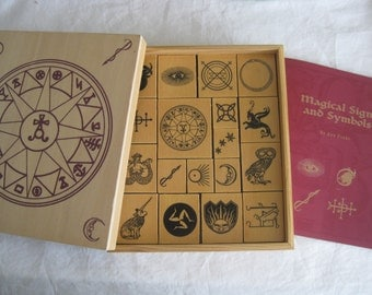 Stamping set of Magical signs and symbols, 18 stamps in a wood box.