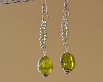 SALE. Peridot Sterling Silver Earrings. Raw Green Peridot Earrings. Free Form Gemstone Spiral Earrings. Hand Forged Wire Wrapped Earrings.