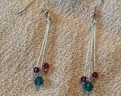 Teal, purple, and wine pink Swarovski crystal earrings.