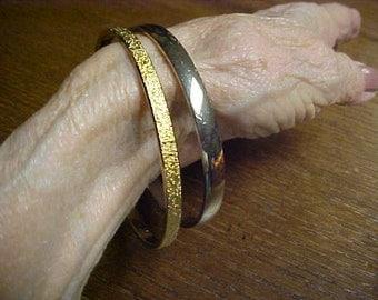 2 vintage bangle bracelets- both signed-1 Monet- 1 Trifari