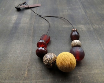 Sale 50 %: Mustard crochet combined with seed, stone, resin, wood and glass in matching brown colors