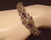 Vintage Avon Victorian Revival Queensbury hinged Bracelet amethyst color stones  1974