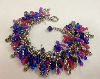Seahorse cha cha charm bracelet in blue and pinks
