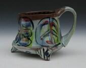 peace mug handmade with feet. Ergonomic handle fun funky pottery art mug