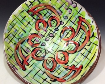 Large serving bowl with music notes and checkered pattern green red black