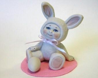 """Bunny kid 3"""" cast in white porcelain holding a white porcelain egg"""