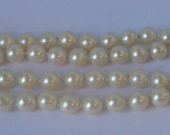 Vintage Knotted, Cream tone, Glass PEARLS Necklace with Gold tone  metal closure.