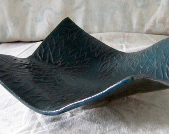 Molded square stoneware dish with leaf texture glazed in teal