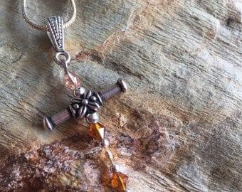 Brown glass beaded cross necklace with snake chain
