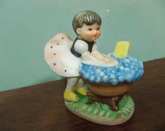 bubbles  and laundry little girl figurine