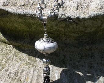 White Himalayan Bead with chain tassel on long chain
