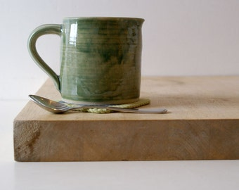 Cafe style pouring jug for milk - hand thrown in stoneware and glazed in forest green