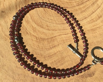 River of garnets with pebbles of pearls.