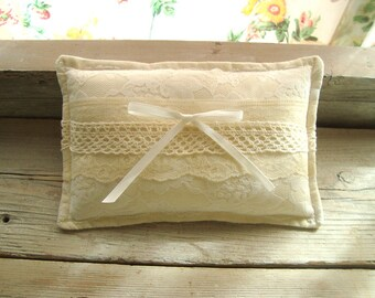 Ringbearer pillow in muslin fabric with layers of vintage lace