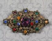 Vintage Czech Multi Colored Rhinestone Bronze Filigree Floral Brooch