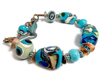 Lampworked Beaded Bracelet/ Copper Beaded Bracelet/ Turquoise and Ivory/ Mykonas Green Patina Fish and Hook Clasp