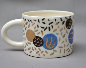 Decorative abstract confetti pattern handmade hand painted gold ceramic art mug