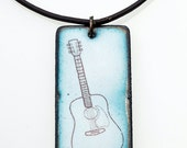 Guitar Necklace. Guitar on Mottled Green Enamel Rectangle Pendant on Leather Cord Necklace. Music Instrument. Vitreous Enamel Jewelry