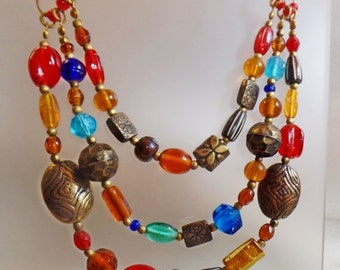SALE Vintage Boho Art Glass Necklace. Three Strand Necklace. Tribal. Red. Blue. Brown. Handmade Beads.
