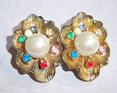 vintage gold tone flower like oval ish clip on earrings with colorful rhinestones and large white bead center 14IN