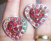 vintage reddish pink rhinestones set in a silver tone setting heart clip on earrings 0515D