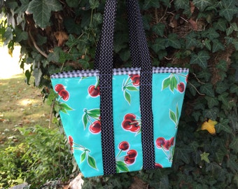 Retro cherries on seafoam green  and black gingham  oilcloth tote bag