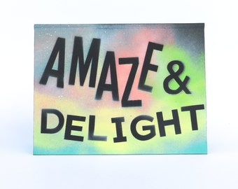 AMAZE & DELIGHT painting on a font book