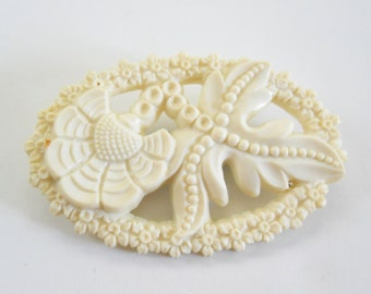 Vintage White Carved Plastic Pin • Plastic Floral Oval pin