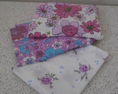 trio of orphaned vintage cotton pillowcases in purples