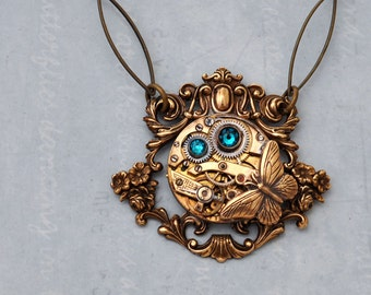steampunk necklace,  ENCHANTED FOREST,  vintage jeweled watch movement and Swarovski blue zircon glass jewel and butterfly charm