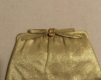 Gold colored evening clutch