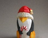 Penguin woodcarving holding a candy cane  #A