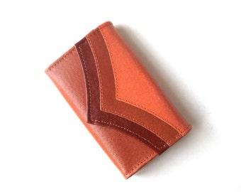 vintage 1970's NOS orange key holder wallet leather princess gardner mid century modern retro fashion accessories small 6 key hooks womens