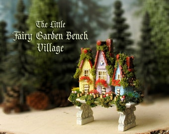 Miniature Fairy Village on a Garden Bench -  Hand-Painted Mini Resin Bench with Three Handmade Fairy Houses, Mushrooms and Wildflowers
