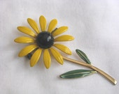 Vintage yellow & black enamel flower pin brooch