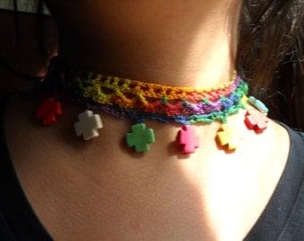 Crosses on crocheted multi-colored choker.