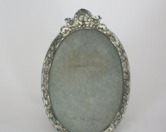 vintage oval silver frame embossed and tarnished