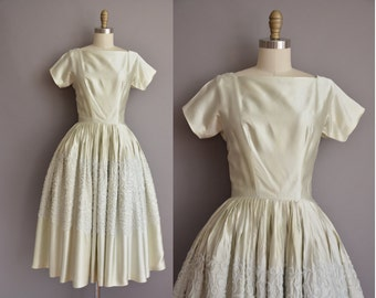 1950s celery green satin embroidered vintage party dress with a huge full skirt