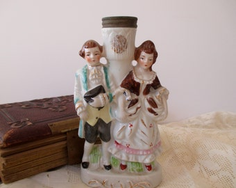 small white porcelain vase with couple