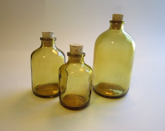 Art floozy jewelry and vintage bits by theartfloozy on etsy for Colored glass bottles with corks