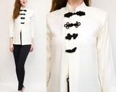 1980s Asian inspired mock neck blouse