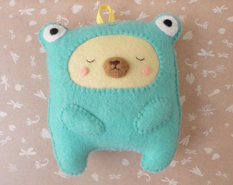 Sweet bear on a frog pajama