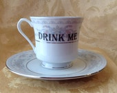 Drink Me Alice In Wonderland Altered Tea Cup and Saucer Set