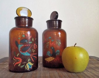 Pair of T.C.W. Co Amber Brown Apothecary jars with Bird Decals